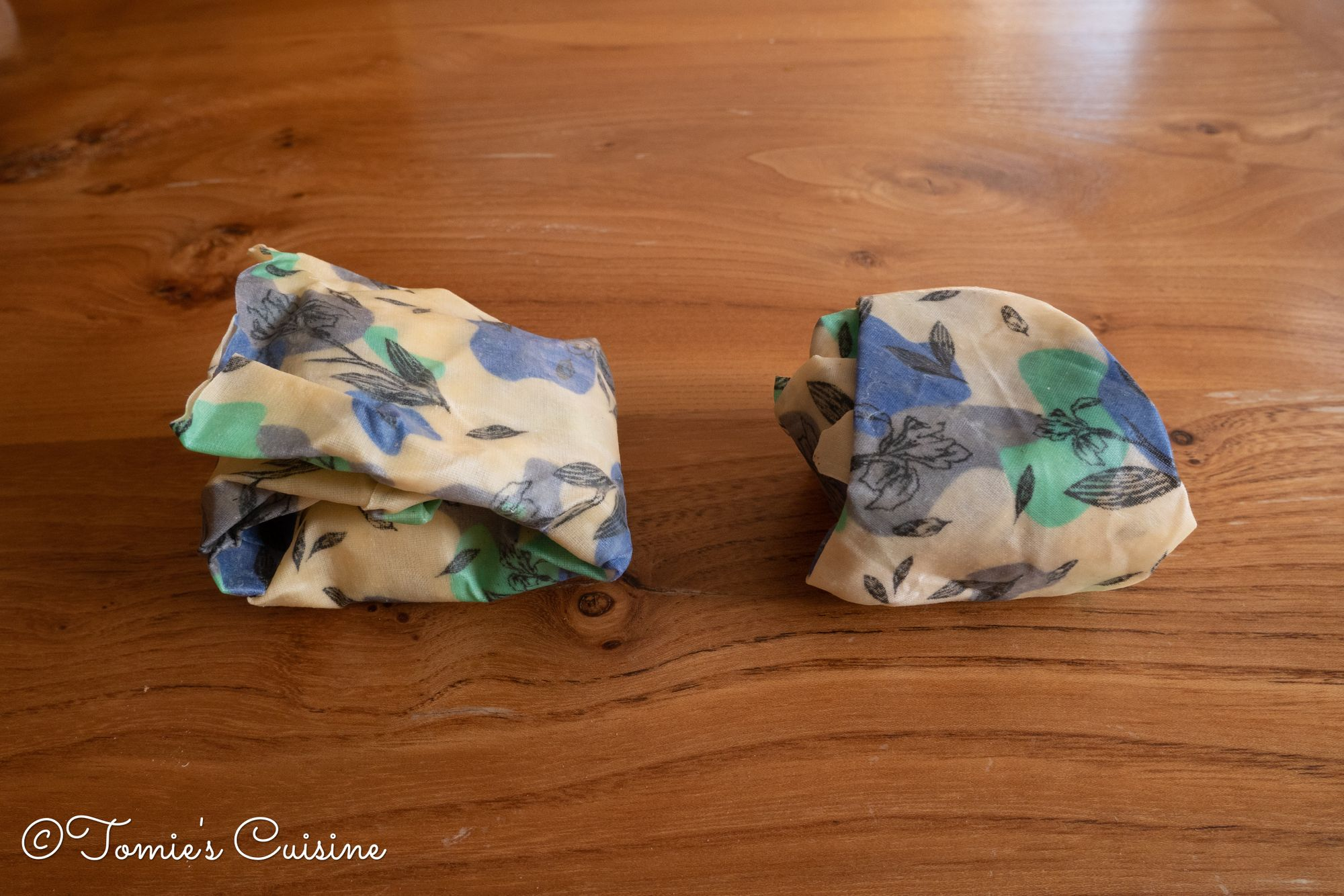 Two different cheese wrapped in beeswax wrap